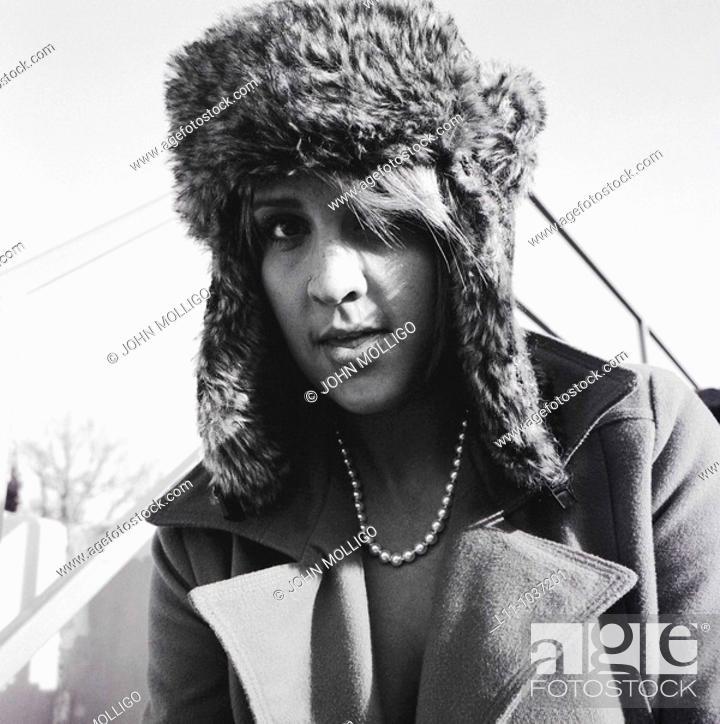 Stock Photo: Woman in ushanka, looking into lens.