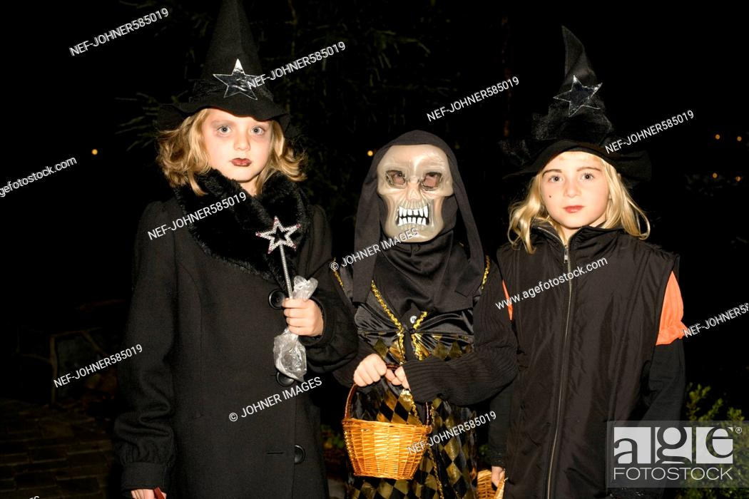 Stock Photo: Three girls during Halloween, Sweden.