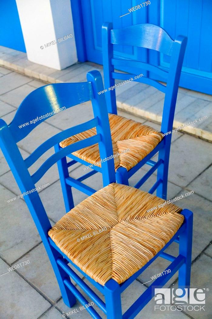 Stock Photo: Blue chairs in the street, Cyclades islands, Greece.