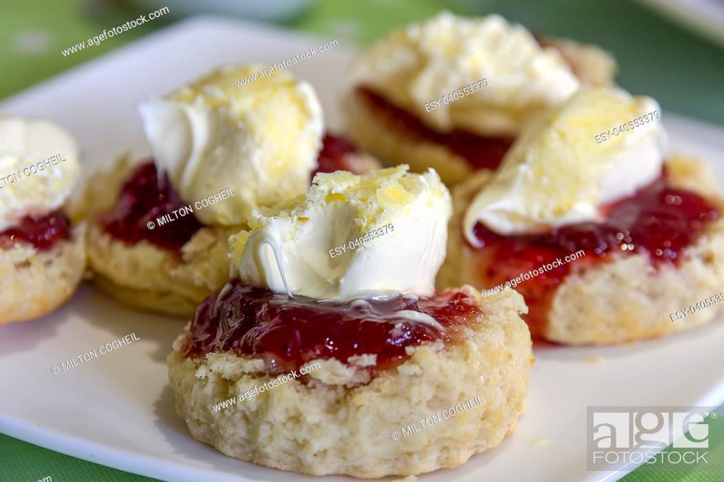 Stock Photo: Cornish cream tea scones. Traditionally cream tea scones in Cornwall are served on a Cornish split, a sweet bread roll, with jam then cream on top.
