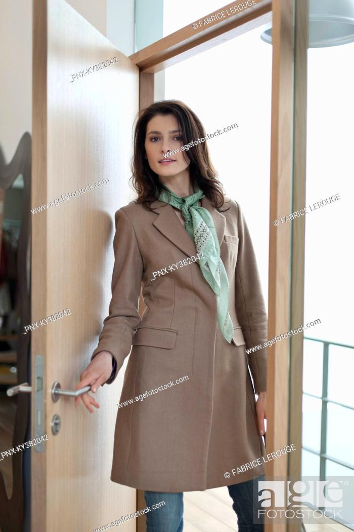 Stock Photo: Woman entering a house.