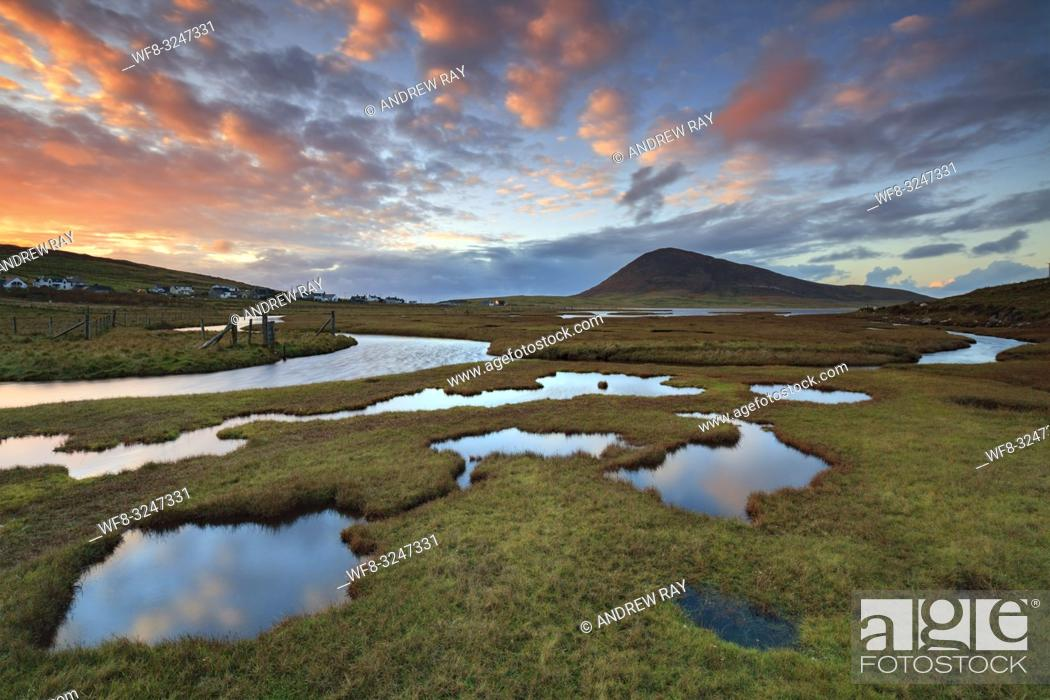 Stock Photo: Sunset captured from Northton Salt Marsh on the Isle of Harris in early November. A long shutter speed was utilised to flatten the ripples on the surface of the.