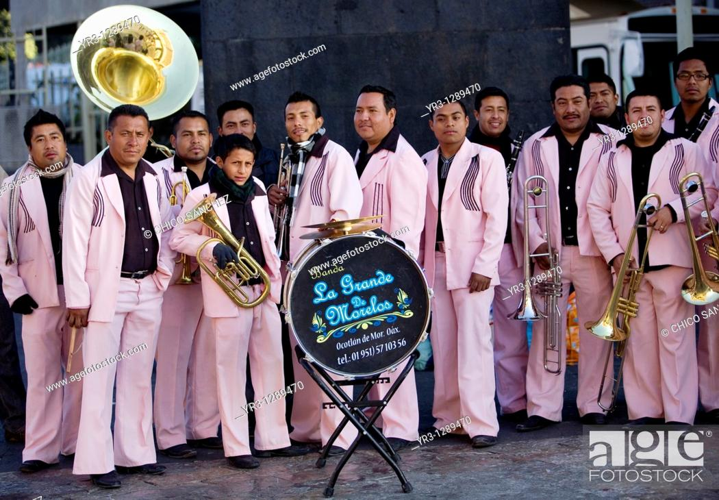 Stock Photo: A music band pose for a picture outside the Our Lady of Guadalupe Basilica in Mexico City, December 9, 2010  Hundreds of thousands of Mexican pilgrims converged.