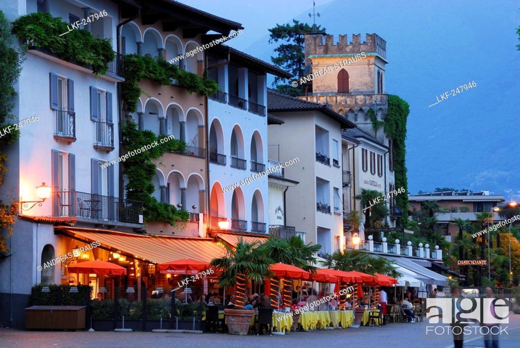 Imagen: Restaurant on the illuminated seaside promenade in Ascona, Ascona, lake Maggiore, Lago Maggiore, Ticino, Switzerland.