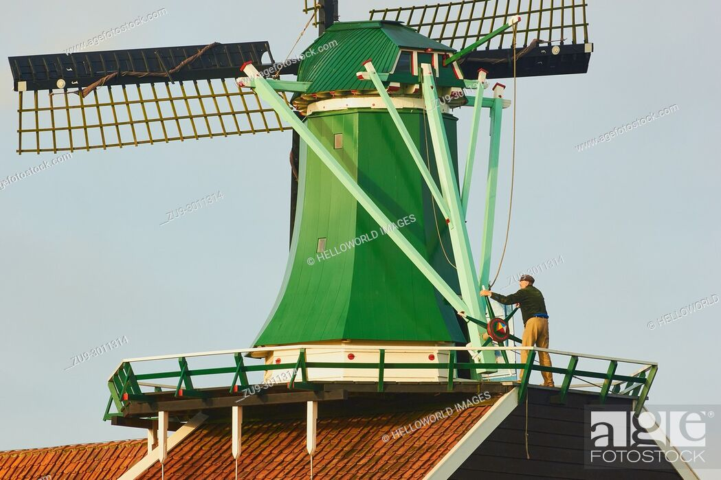 Stock Photo: Miller operating windmill, Zaanse Schans a village near Zaandijk in the municipality of Zaanstad, North Holland, Netherlands.