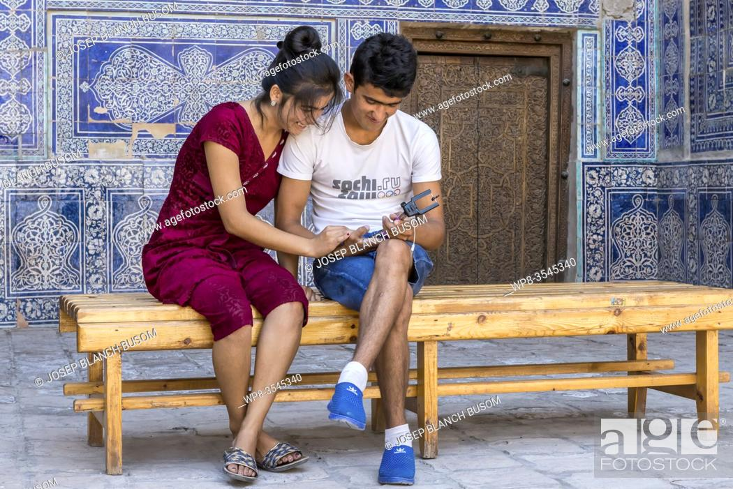 Stock Photo: Young Uzbeks in a moment of intimacy. Khiva, Uzbekistan.