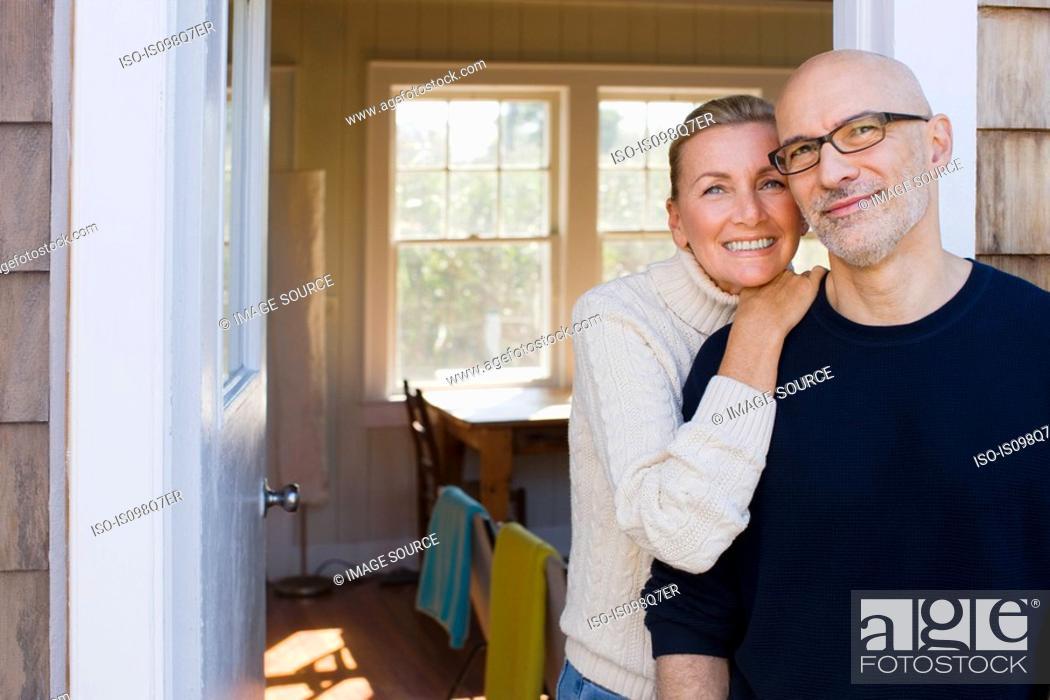 Stock Photo: Couple outside house.