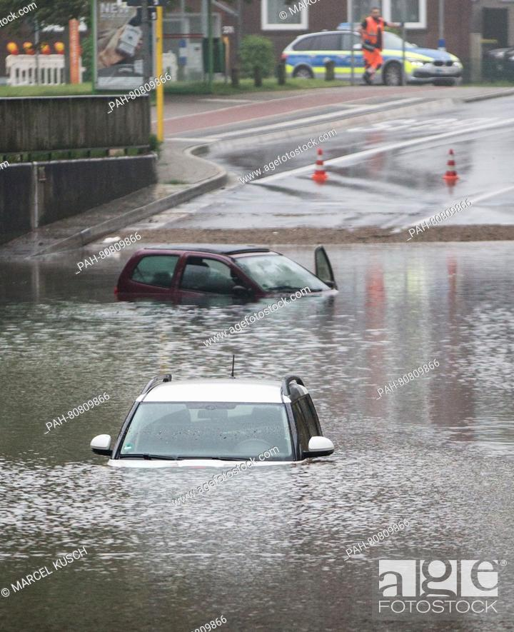 Stock Photo: Cars can be seen in a flooded underpass in Oberhausen,Germany, 30 May 2016. Photo:MARCELKUSCH/dpa | usage worldwide. - Oberhausen/North.