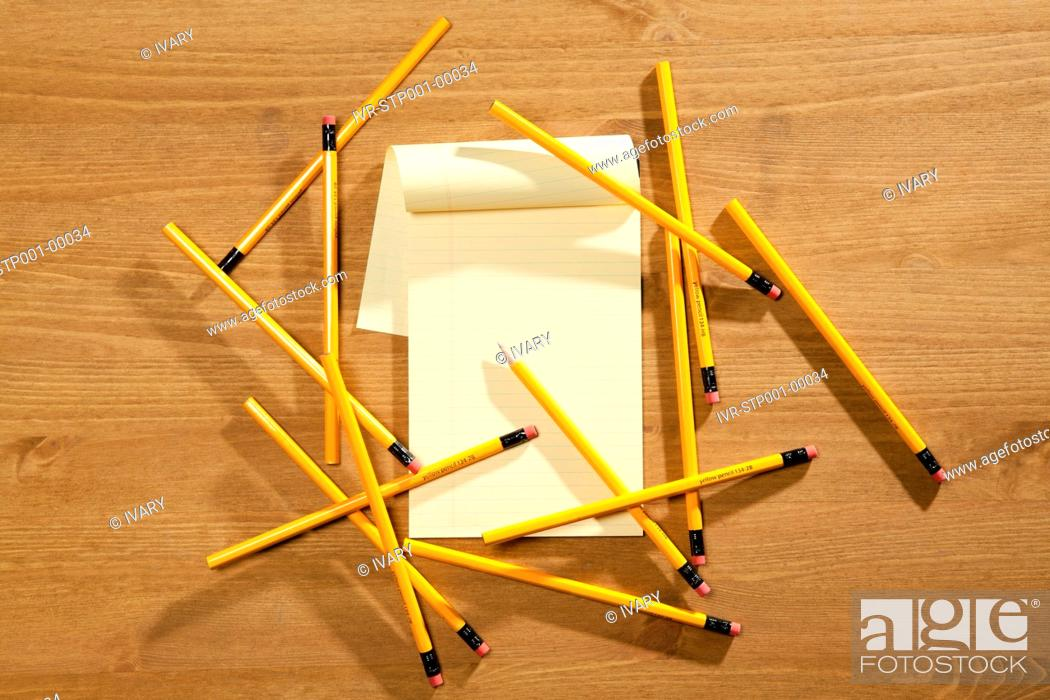 Stock Photo: High Angle View Of The Pencils And Notepad.