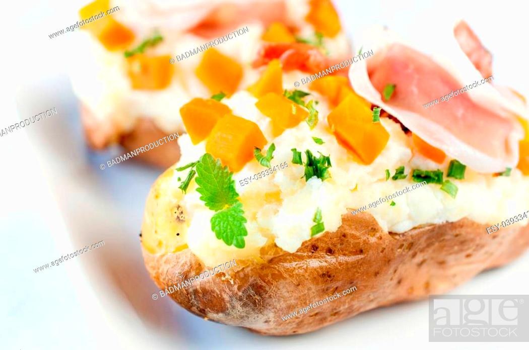 Stock Photo: Tasty potato stuffed with cheese cream and prosciutto.