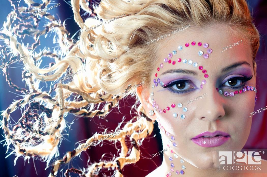 Stock Photo: blond girl with fancy hairstyle and makeup.