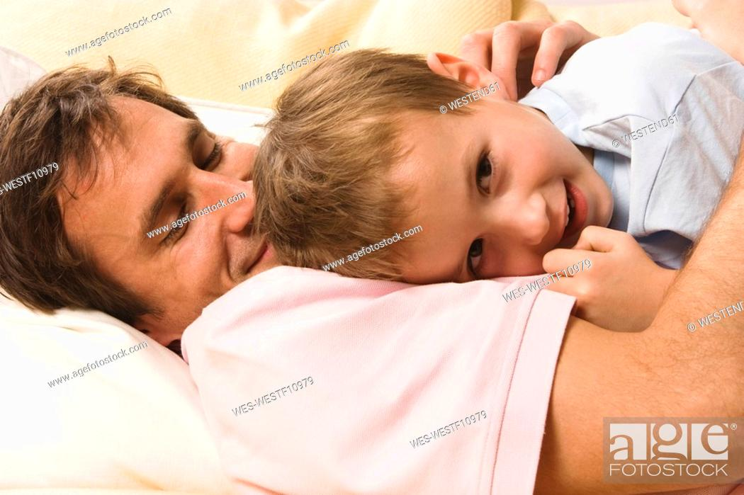 Stock Photo: Father and son 4-5 snuggling with each other, close up.