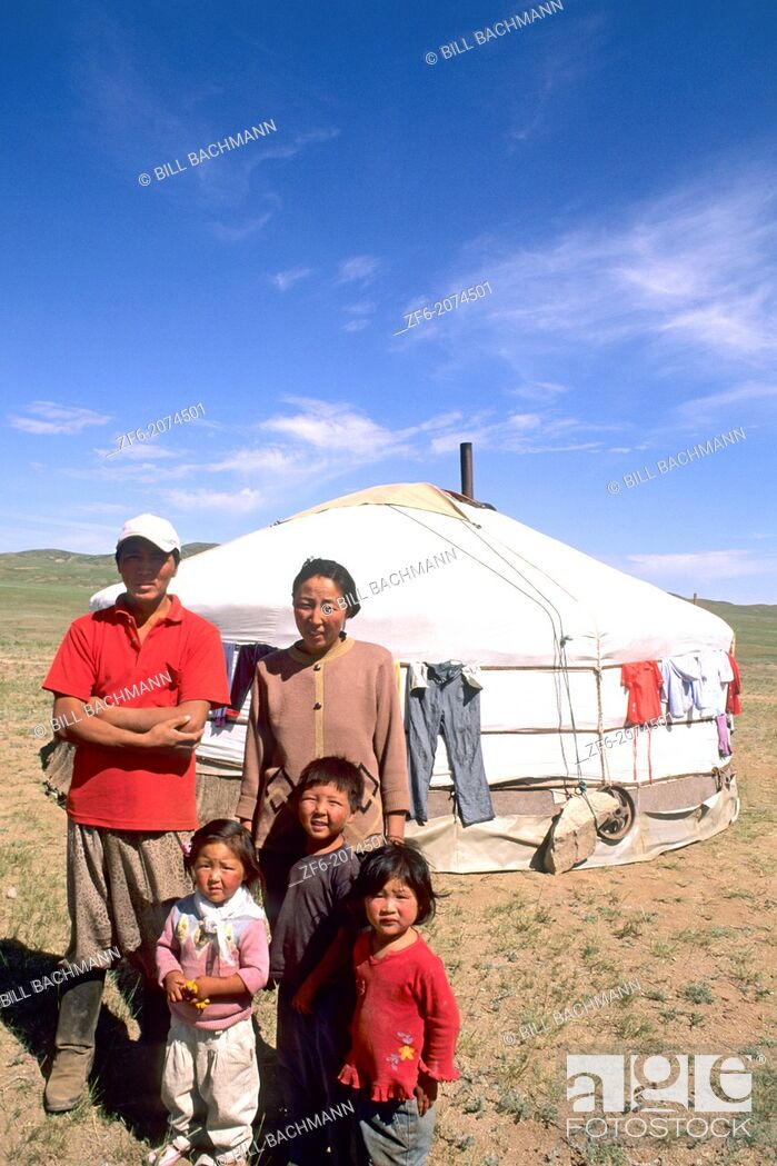 Stock Photo: Mongolian Family by Ger in the Nomadic Country of Mongolia.