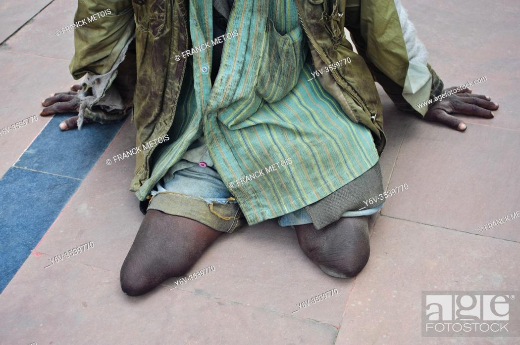 Stock Photo: A double leg amputee is begging ( Bihar, India).