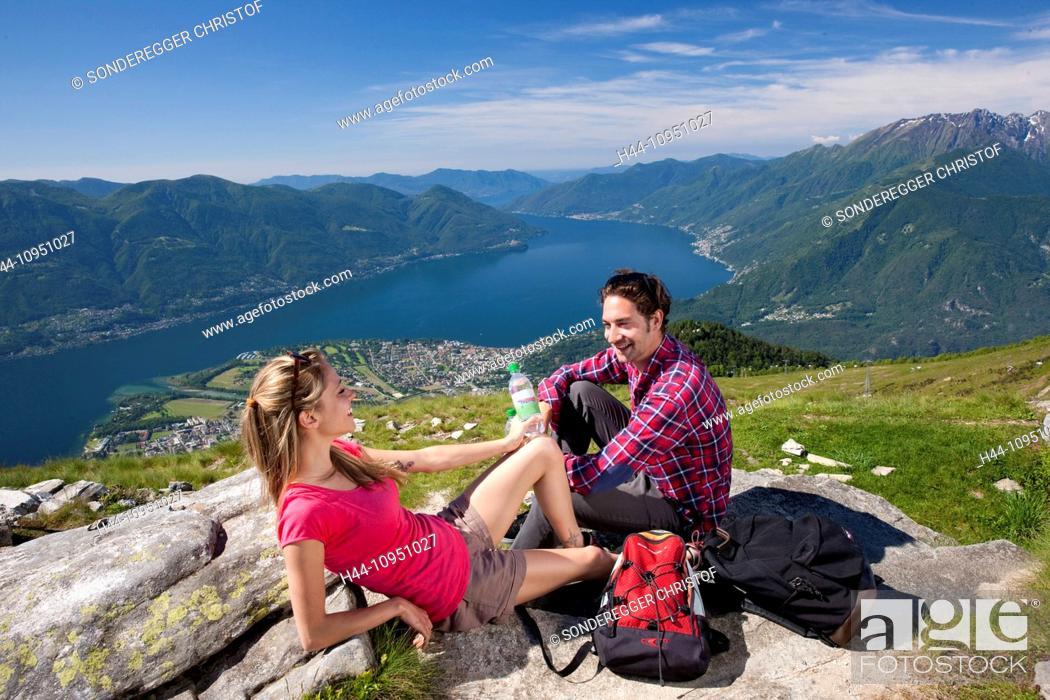 Imagen: Switzerland, Europe, canton, TI, Ticino, Southern Switzerland, mountain, mountains, lake, walking, hiking, view, Locarno, Cardada, Cimetta, couple, man, woman.