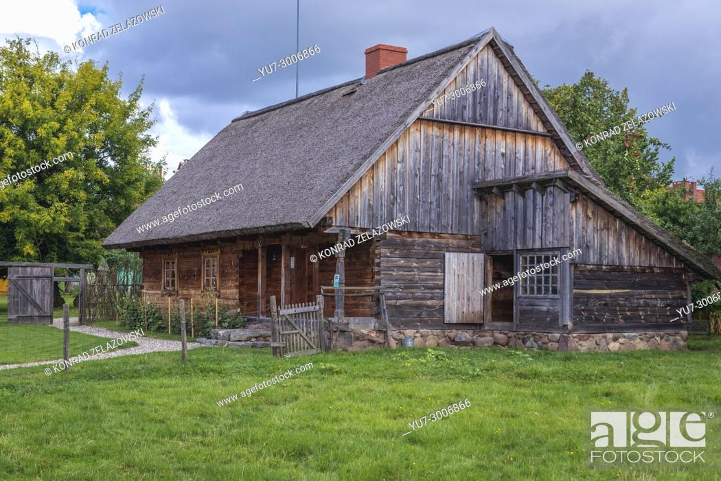 Stock Photo: Wooden traditional cottage in Museum of Folk Culture in Wegorzewo town, Warmian-Masurian Voivodeship of Poland.