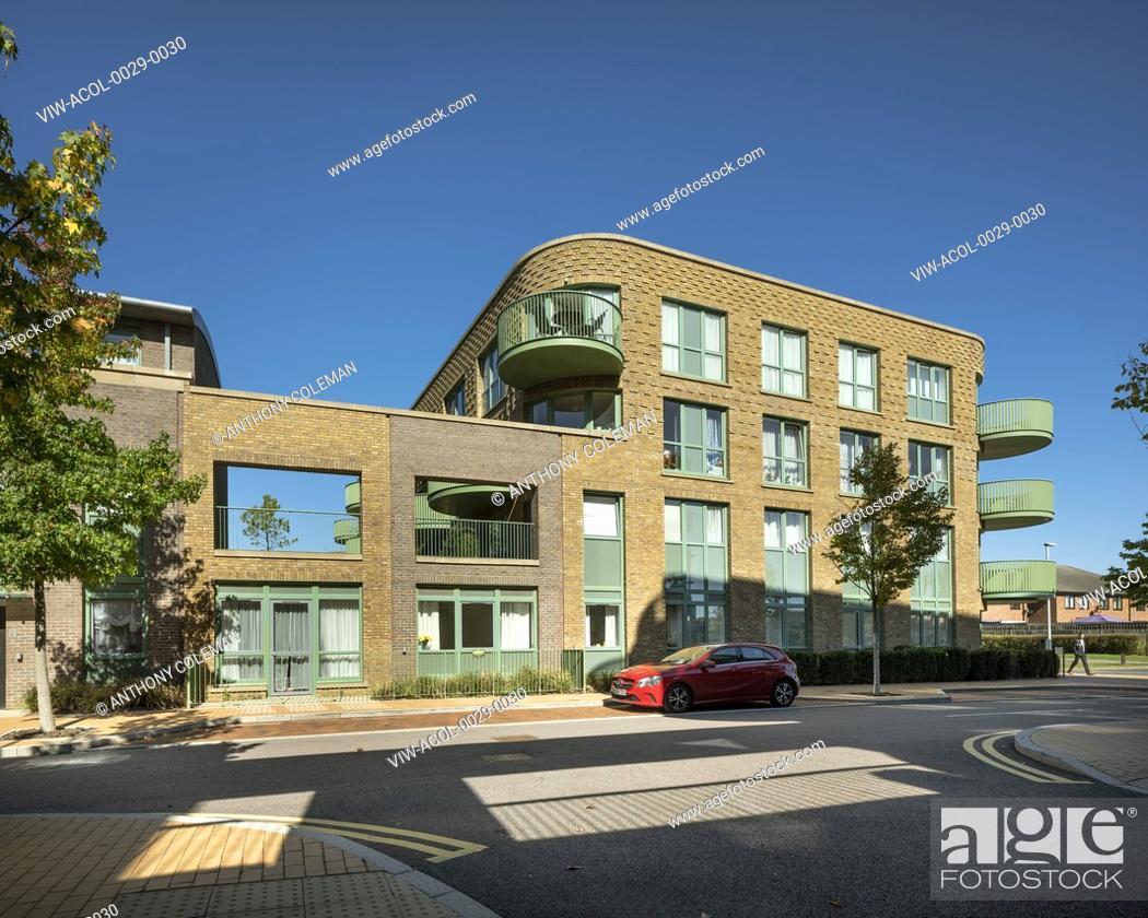 Stock Photo: Townhouses and apartment block from street. Kidbrooke Village Phase 5, Kidbrooke, United Kingdom. Architect: CZWG Architects LLP, 2019.
