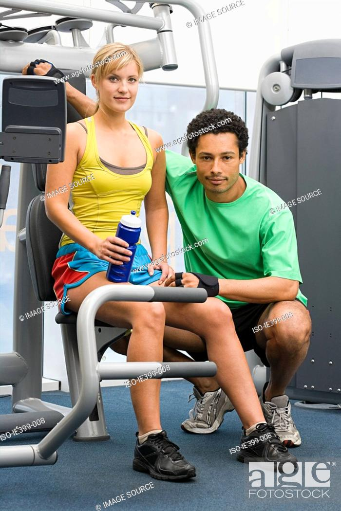 Stock Photo: Woman and fitness instructor.