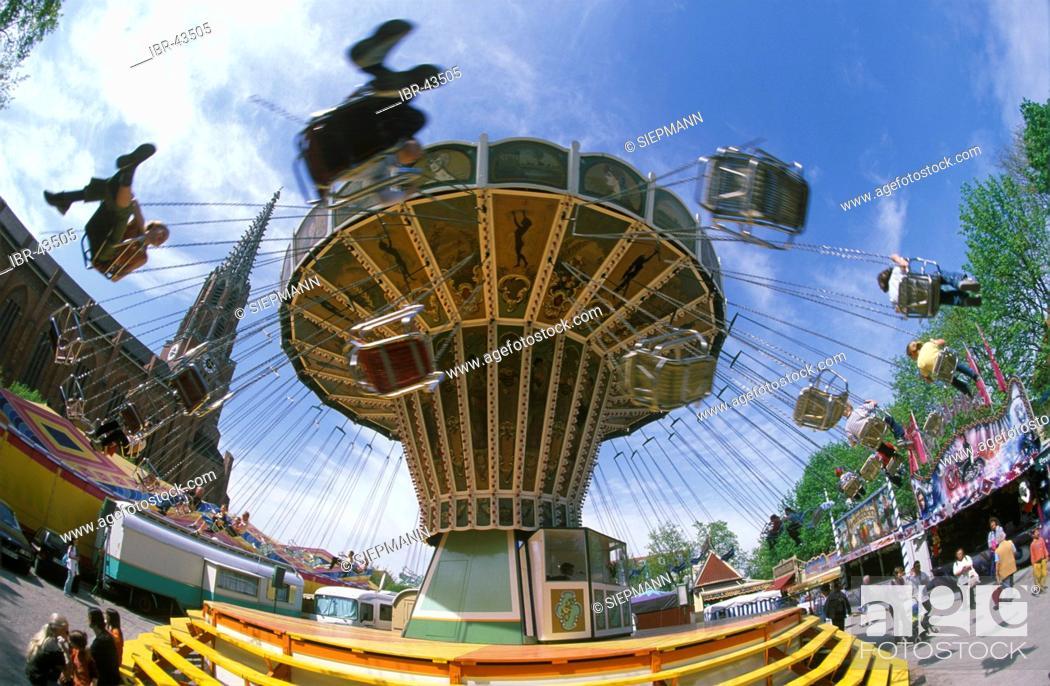 Stock Photo: Chairoplane Wheel carousel machine Auer Dult Mariahilfplatz Au Munich Bavaria Germany.