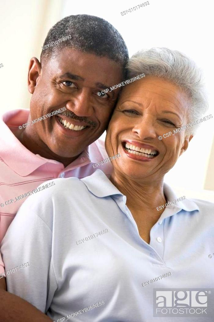 Stock Photo: Couple relaxing in living room and smiling.