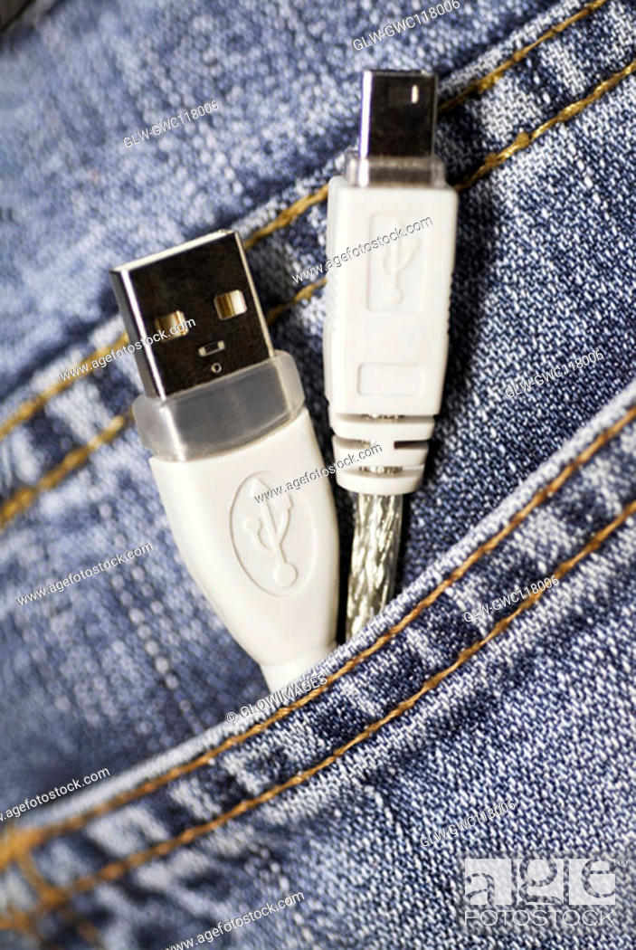 Stock Photo: Close-up of two USB cables in a person's pocket.