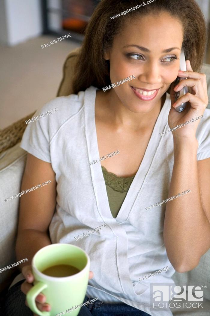 Stock Photo: African American woman talking on telephone.