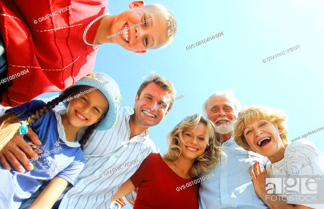 Stock Photo: Low angle view of family smiling.
