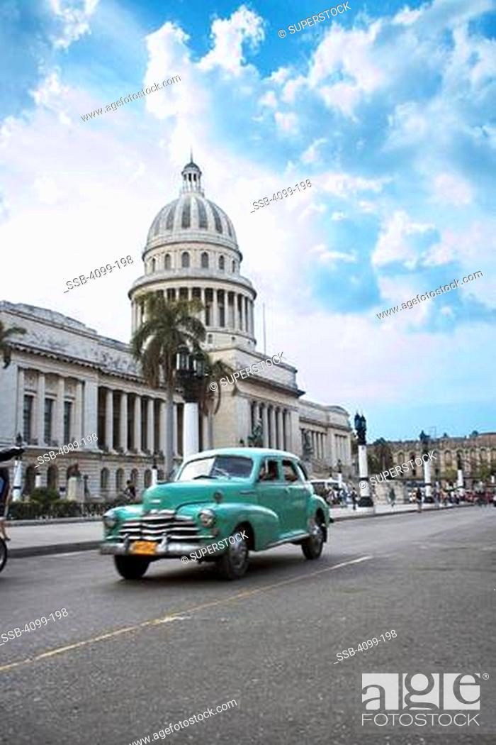 0599fa4b Stock Photo - Car on the road in front of a government building, El  Capitolio, Havana, Cuba