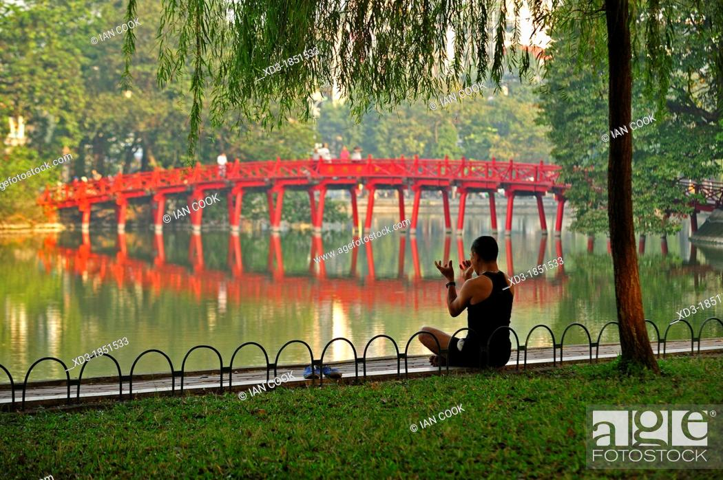 Stock Photo: early morning exercises beside Hoan Kiem Lake, Hanoi, Vietnam.