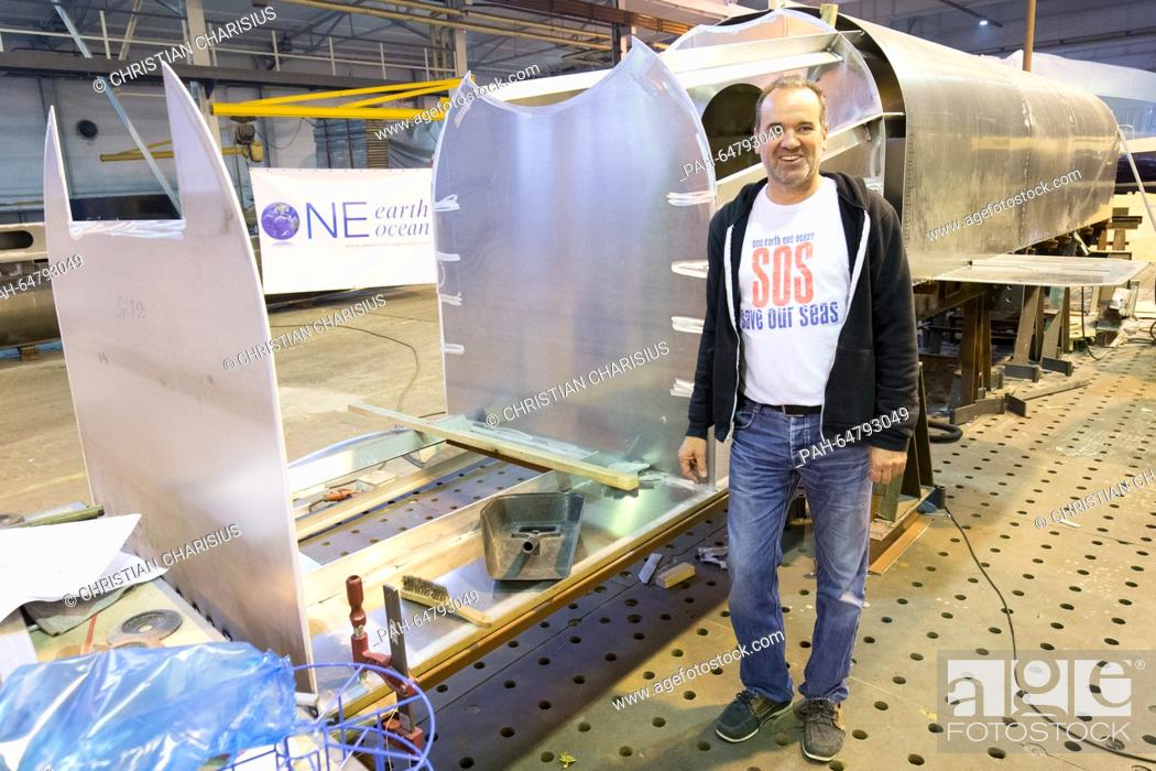 Stock Photo: Guenther Bonin, chairman of the 'One Earth - One Ocean' environmental protection association, stands next to a shell structure of a hull for the rubbish.