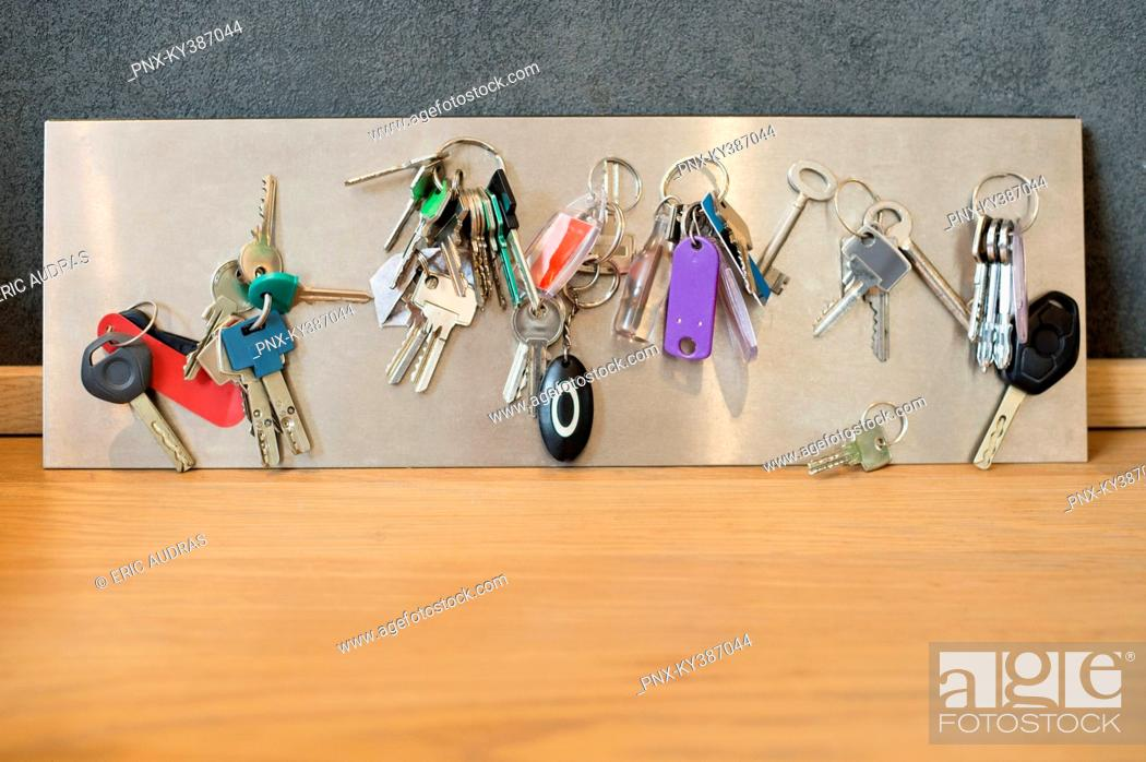 Stock Photo: Assorted keys on a metal sheet.