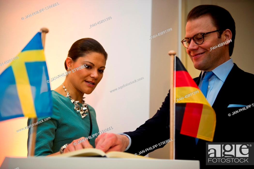 Sweden's Crown Princess Victoria and Prince Daniel sign the guest