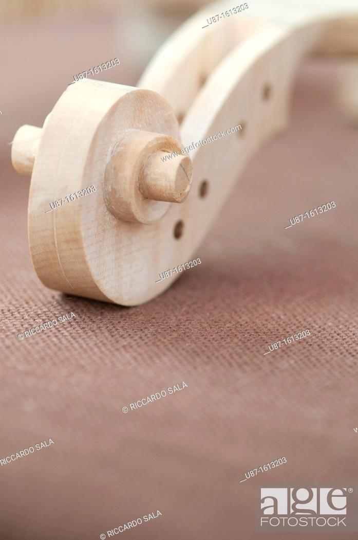 Stock Photo: Italy, Lombardy, Cremona, Violin Maker Worshop, Close up of Violin Scrolls Unvarnished.