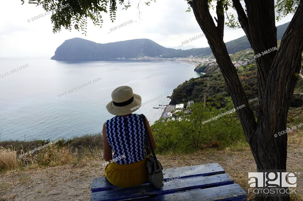 Imagen: Woman looks at Canneto, Island of Lipari, Aeolian Islands, Italy.