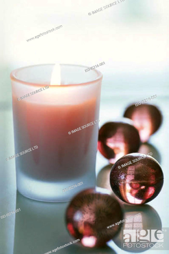 Stock Photo: Candle with bath pearls.