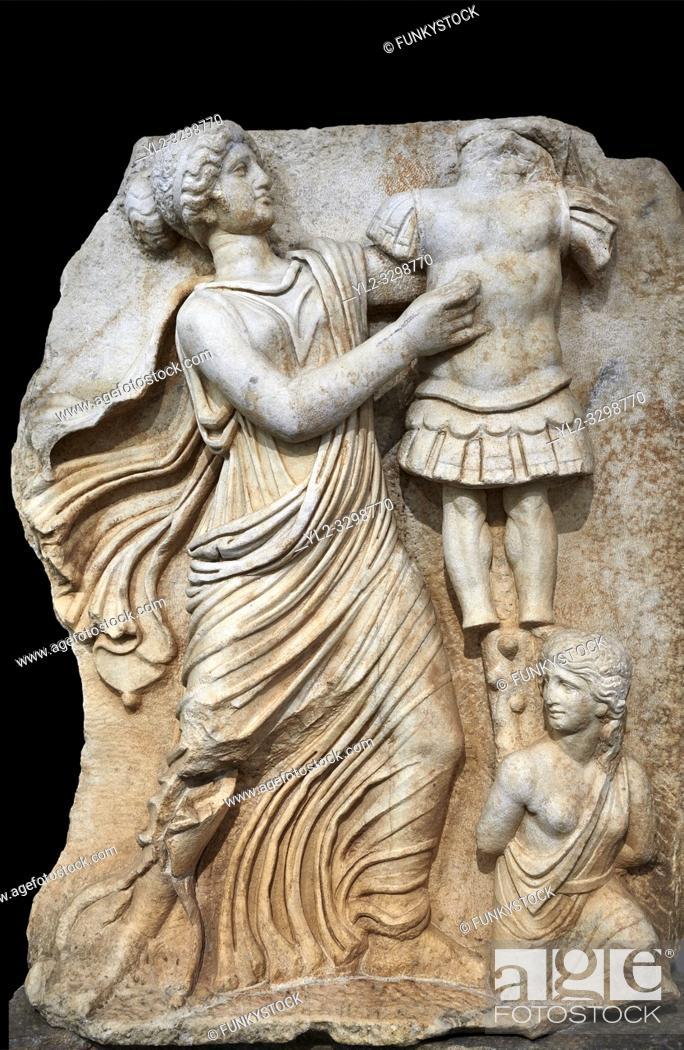 Stock Photo: Roman Sebasteion relief sculpture of a Goddess inscribing a trophy, Aphrodisias Museum, Aphrodisias, Turkey. Against a black background. .