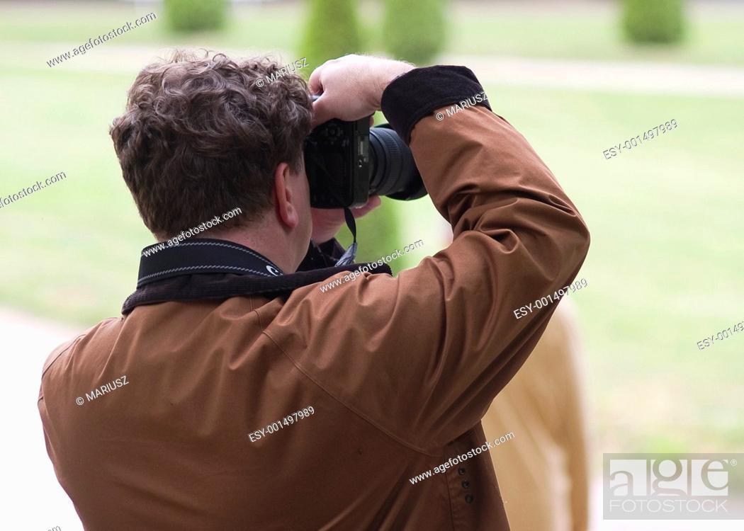 Stock Photo: Photographer.