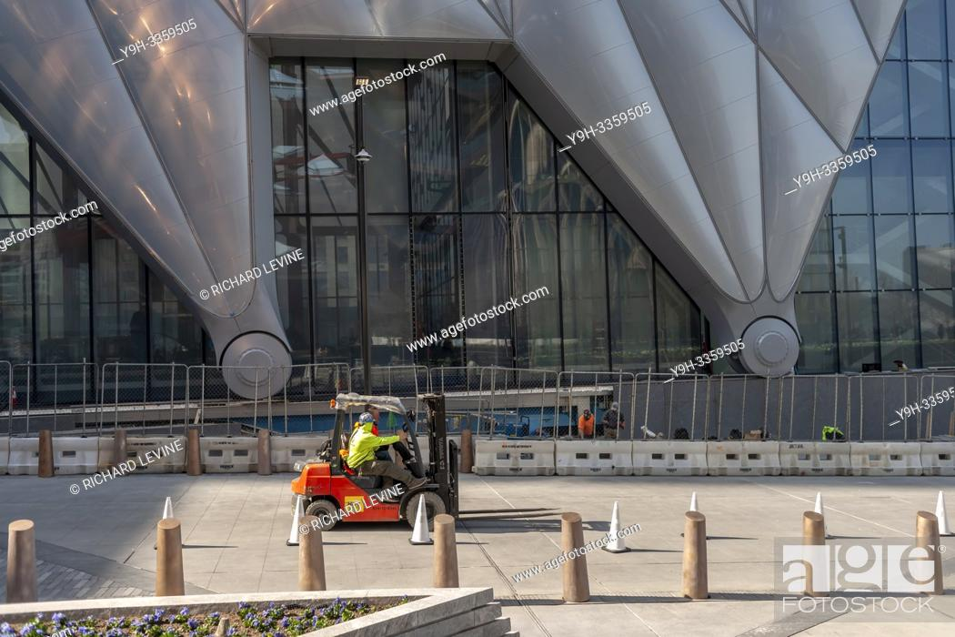 """Stock Photo: Workers scurry about preparing """"""""The Shed"""""""" arts space in Hudson Yards for its opening, seen on Saturday, March 30, 2019 . (© Richard B. Levine)."""