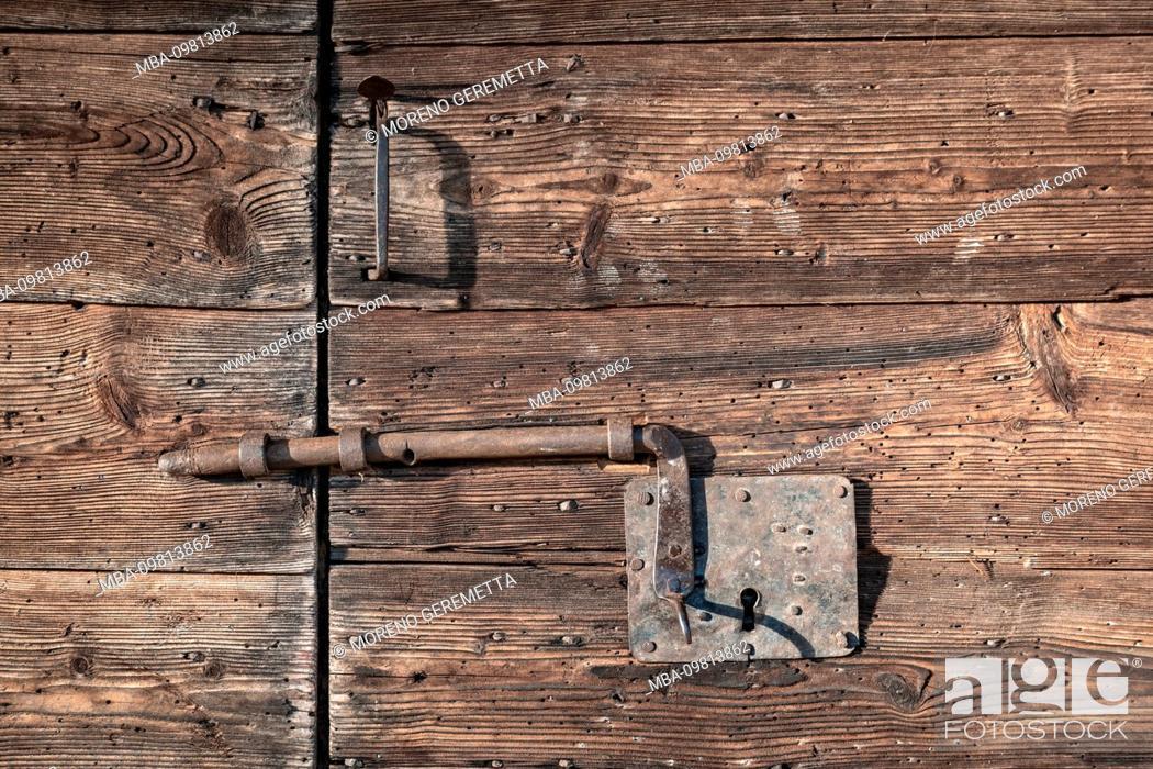 Photo de stock: Wooden vintage door with latch rusted lock, Agordino, Dolomites, Agordo, Belluno, Veneto, Italy.