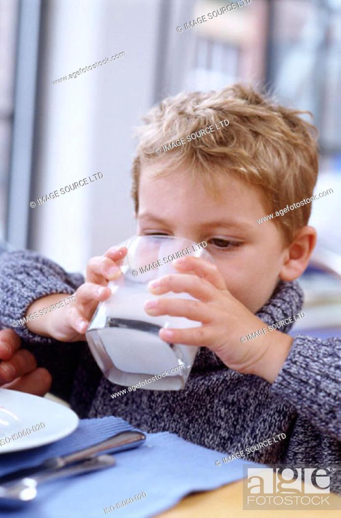 Stock Photo: Boy at breakfast.