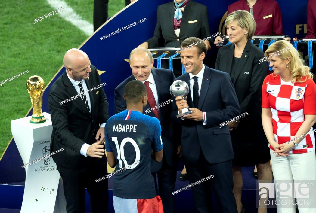 Stock Photo: 2018 FIFA World Cup Final: France v Croatia Featuring: Gianni Infantino, Vladimir Putin, Kylian Mbappe Where: Moscow, Russian Federation When: 15 Jul 2018.