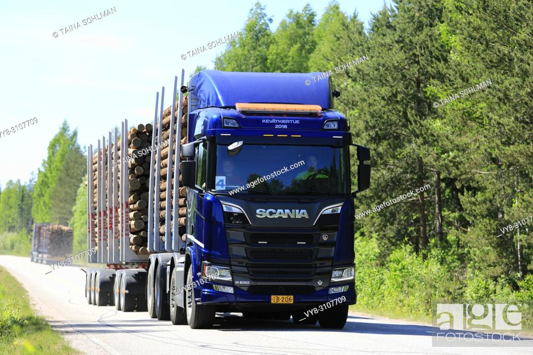 Stock Photo: Blue Next Generation Scania R650 logging truck on test drive on rural road in spring during Scania Tour 2018 in Lohja, Finland - May 25, 2018.