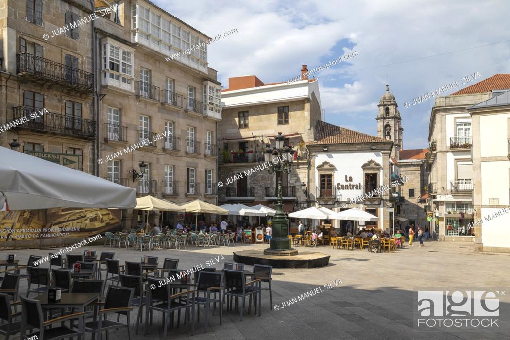 Stock Photo: People sitting in an outdoor cafe on Plaza Da Constitution, Vigo, POntevedra, Galicia, Spain.