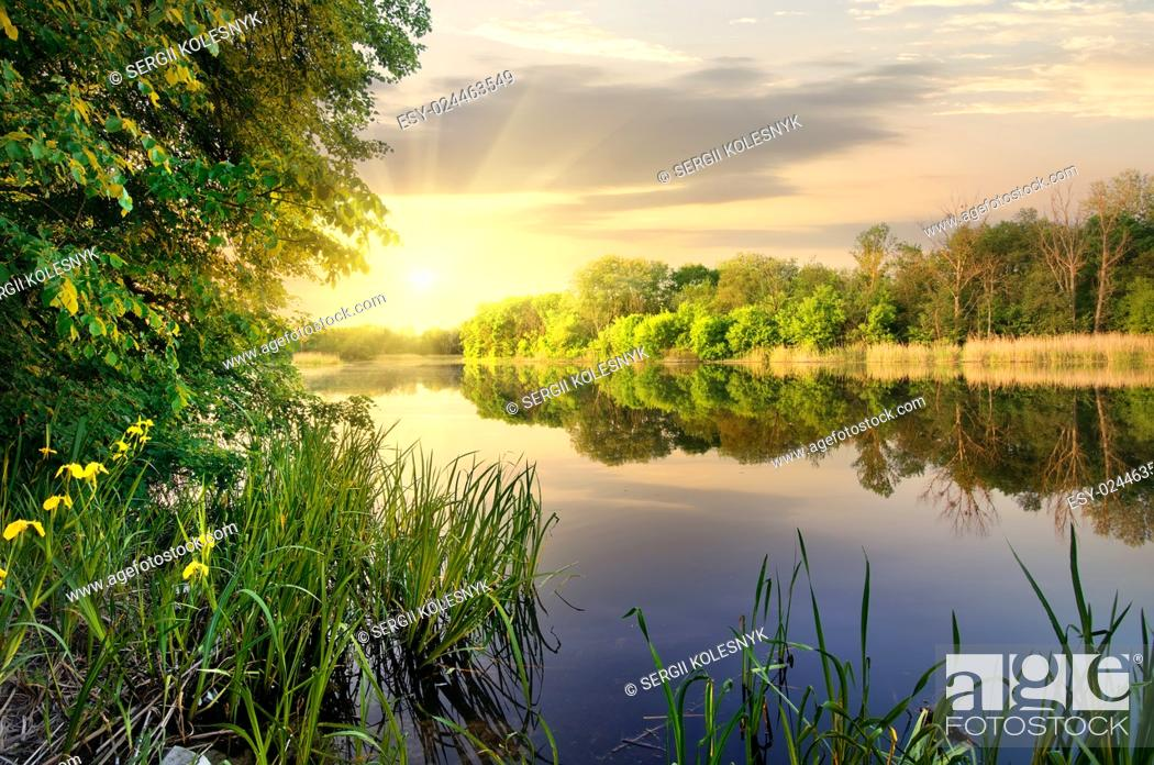 Stock Photo: Vibrant sunset on river in the autumn.