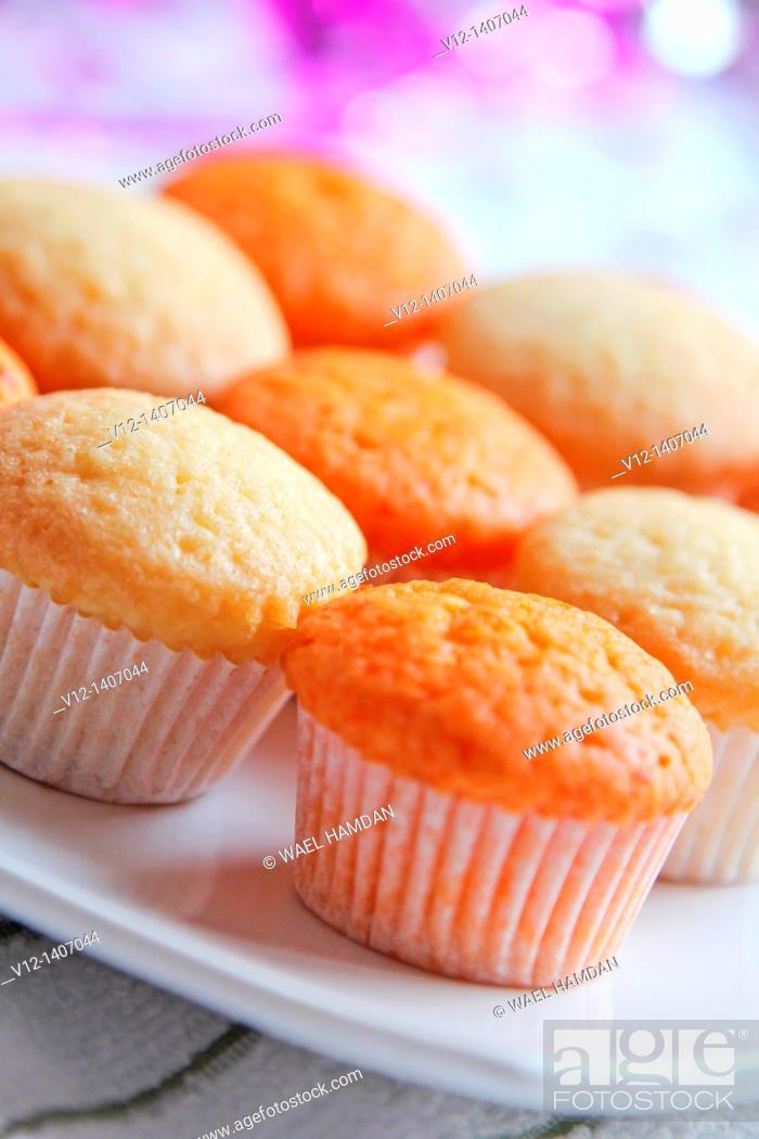 Stock Photo: fresh cupcake with vanilla and orange.