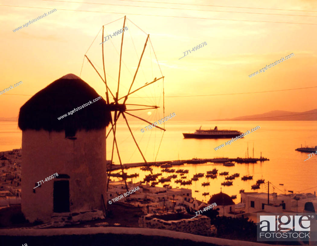 Stock Photo: Windmills at dusk. Mykonos. Greece.