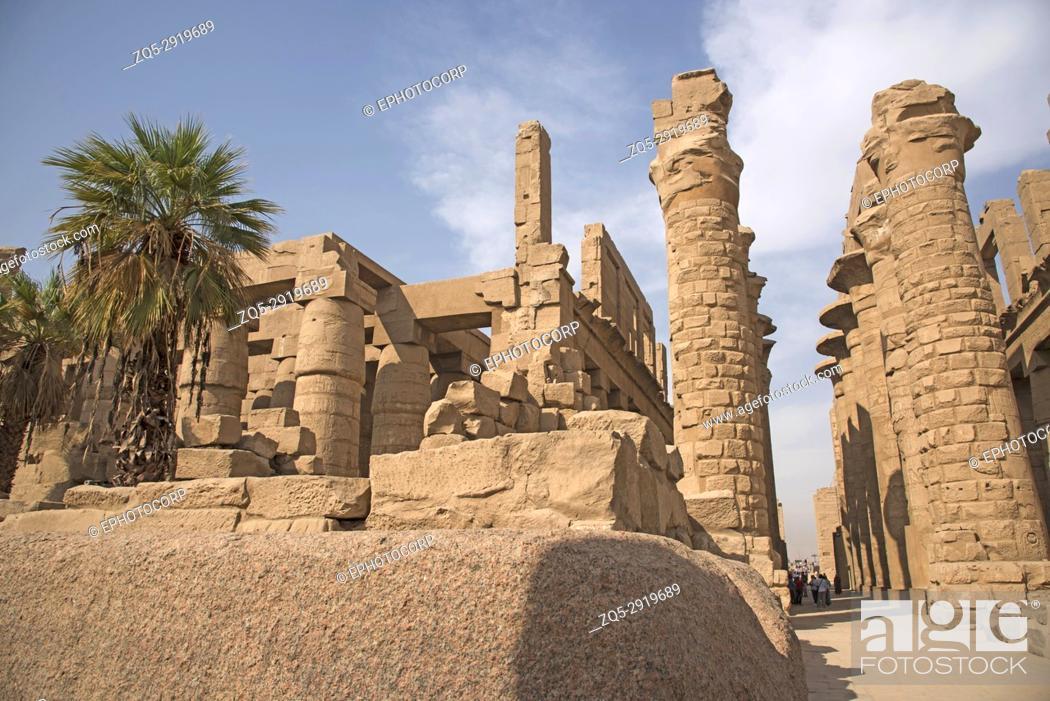 Stock Photo: Inner view of a temple and carved pillars of the great hypostyle hall in the Precinct of Amon Re, Situated at Karnak Temple complex.