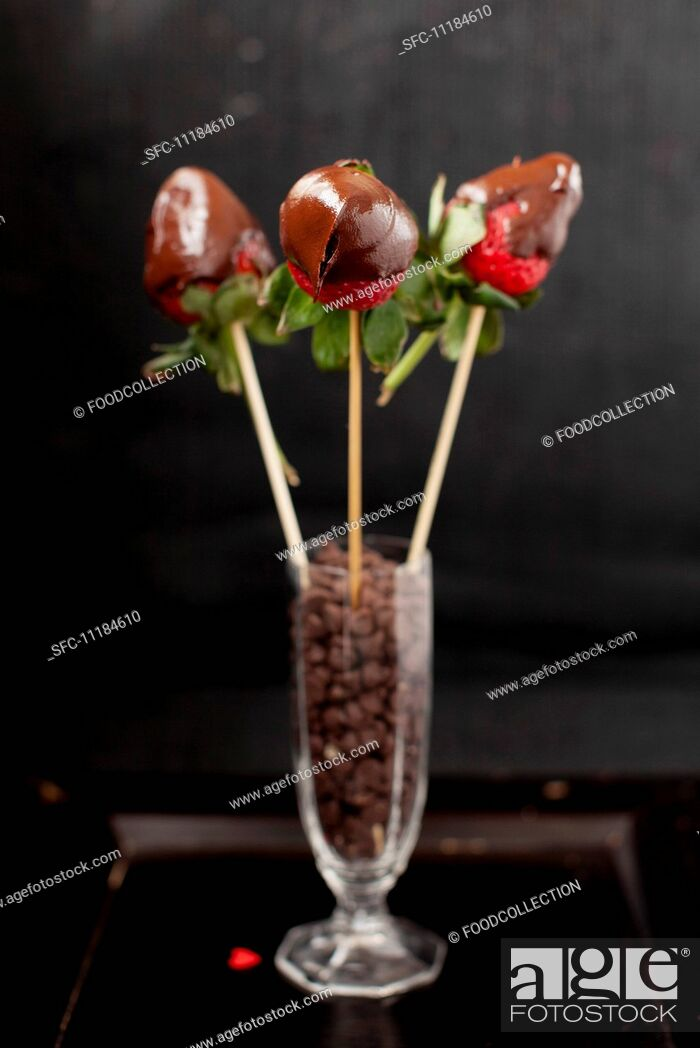 Stock Photo: Chocolate Covered Strawberries; Skewered and in a Glass of Chocolate Chips.