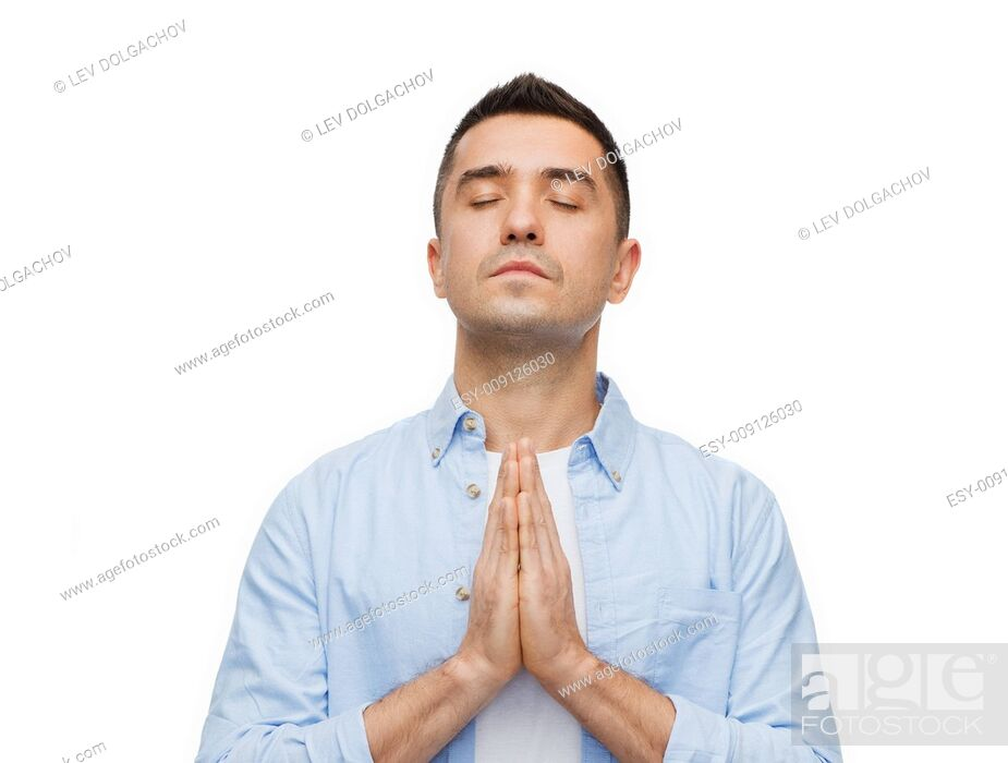 Stock Photo: faith in god, religion and people concept - happy man with closed eyes praying.
