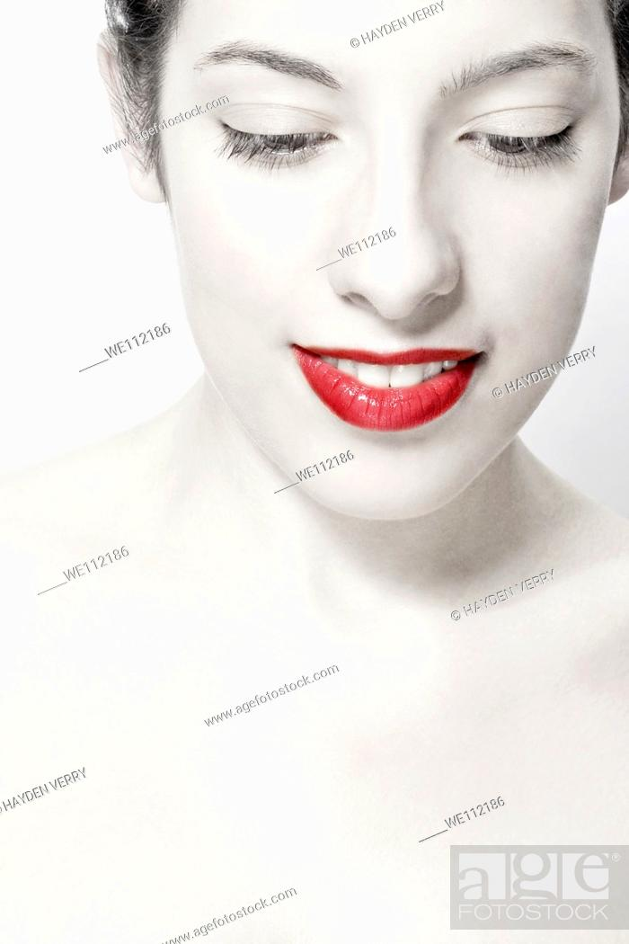 Stock Photo: Young woman with red lipstick.